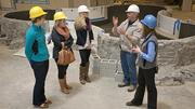 Natural Science Center Executive Director Glenn Dobrogosz and Marketing Director Steffany Reeve, right, discuss SciQuarium exhibits currently under construction with members of the Greensboro Convention and Visitors Bureau marketing team. The SciQuarium is scheduled to open this summer.