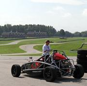 An instructor with the VIR Driving Experience talks with a student prior to heading out on the track. Virginia International Raceway offers the race car driving classes using the Ariel Atom, a high-powered race car produced at the adjoining Virginia Motorsports Technology Park.