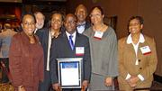 Azeez Aileru (center), a Winston-Salem State University professor who won the Research and Development Award, stands with a group from the university. Aileru is director of WSSU's Biomedical Research Infrastructure Center.