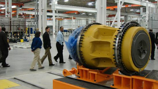 In November, visitors to the Caterpillar plant in Winston-Salem walk past one of the massive wheels that will be produced in the plant for use on the heavy equipment maker's largest mining trucks.