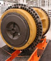 A rear wheel sits in the assembly area of the Caterpillar plant in Winston-Salem waiting to become part of the axles that will be built and shipped from the 1 million-square-foot plant. Local officials and members of the business community helped celebrate the grand opening of the plant on Wednesday.
