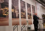 Rusty Davis, operations manager for the Winston-Salem Caterpillar plant, talks to the crowd of close to 400 at the plant's grand opening.