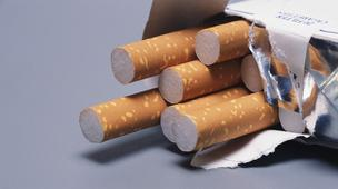 Tobacco companies are hoping to stop the implementation of an Australian law banning brand logos from cigarette packs.
