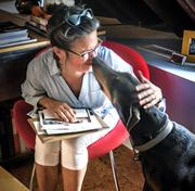 Woodrow goes nose-to-nose with Lani Paul, the photography producer at Woodbine in Winston-Salem. The advertising firm enjoys having dogs in the office because they bring smiles and laughter to the office, greet guests and clients with wags, reduce stress and create bonds between employees.