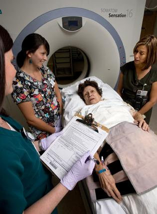 A medical interpreter at Forsyth Medical Center  translates for a patient prior to a CT scan. Davidson County Community College is the first community college in the state to offer a degree in medical interpretation.