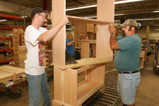 Workers at Linwood Furniture in Lexington build an entertainment center. The company filed for bankruptcy protection in March and is moving to liquidate its assets.