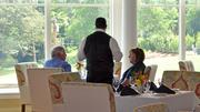 Club members enjoy lunch at the newly renovated dining room inside the clubhouse.