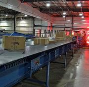FedEx's automated system directs the packages to one of three load sides, which are determined by volume and the package's destination. They are then diverted to a set of collectors to prepare for a second scan. Collectors are angled rollers that keep the packages in the order of the first scan, and also help slow packages' momentum just slightly from their rapid speed on the conveyor belts as they approach the second scan. That helps create space between the packages.