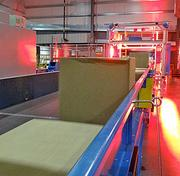 Almost instantly, the packages run through the second, six-sided scan tunnel, which will determine the correct chute for the package. FedEx's electronic package data interchange automatically updates its tracking system as soon as package is scanned.