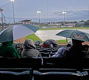 A steady rain kept Greensboro Grasshoppers fans under umbrellas -- and the field under a tarp -- for opening night. The season opener for the Hoppers was postponed until Friday night.
