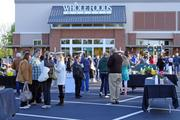 A crowd gathered starting at 7:30 a.m. in the Whole Foods parking lot at Greensboro's Friendly Center.
