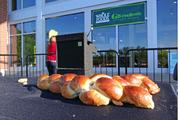 The bread was quickly devoured by members of the crowd and representatives from Sears and Whole Foods.