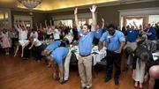 Attendees at the Triad's Healthiest Employers awards program get in their morning exercise.