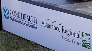 Federal regulators have offered their blessing to the planned merger of Cone Health and Alamance Regional Medical Center.