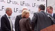 Gov. Bev Perdue speaks with Li & Fung company officials at an announcement of the company's expansion on Monday.