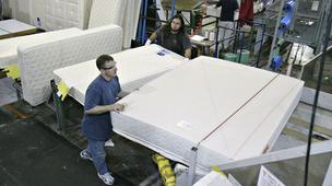 Sealy Corp. workers load mattresses