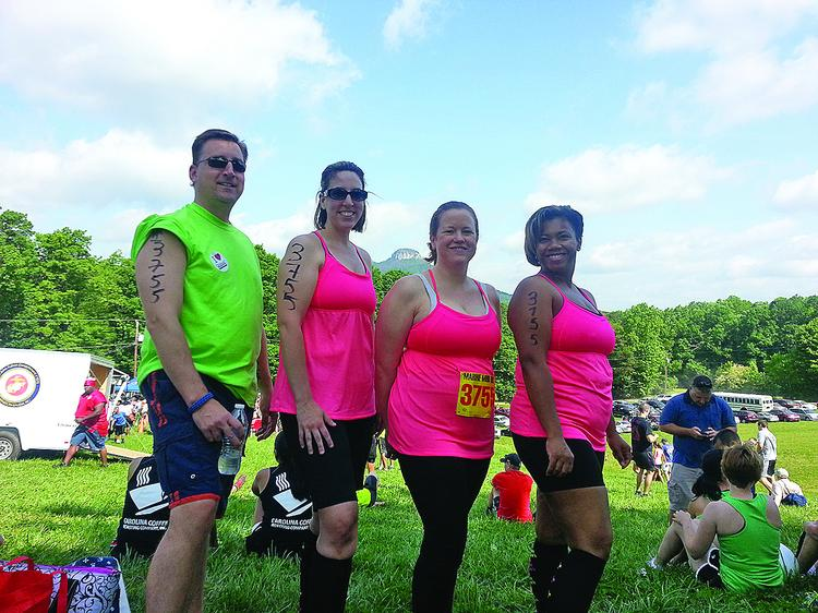 From left, Brian Uber, Jennifer Bourguignon, Alexa Maglio and Rickisha  Mitchell were part of the Allegacy Federal Credit Union team this year  at the Marine Mud Run in Pinnacle.