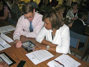 Marshall Matson, principal at Mendenhall Middle School in Greensboro, and Keisha McMillan from Aycock Middle School explore the Amplify tablets during a Guilford County Schools principals' meeting.