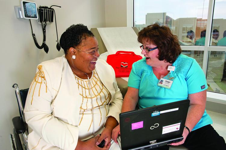 Ginger Leonard, right, a nurse and patient navigator at Cornerstone's Heart Function Clinic at Carolina Regional Heart Center in High Point, talks with a patient.