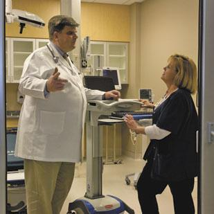 Dr. Charles Record, medical director of Kernersville Medical Center, talks with nurse Brenda Currie in an empty emergency department in preparation of the hospital's March 16 opening.