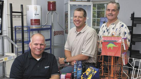 Jeff McIntyre, left, is president of McIntyre Metals in Thomasville. Charles Neese, center, and John Neese Jr. owned Wire Products of Greensboro, which recently merged with McIntyre Metals.