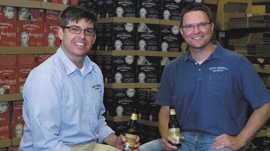 Chris Lester, left, and Kayne Fisher are the owners of Natty Greene's Brewing Co. in Greensboro. The pair have plans to increase production and distribute the beer statewide.