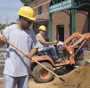The Greensboro City Council approved a request from The Nussbaum Center for Entrepreneurship that payments on a $1.2 million loan that helped the center to relocate not begin for another year. Above, work is done last year on the grounds of the new facility.