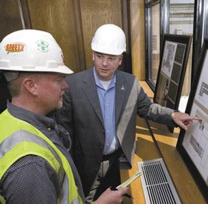 Sam Funchess, right, president and CEO of the Nussbaum Center for Entrepreneurship in Greensboro, talks with Jeff Long, a superintendent with D.H. Griffin Construction.
