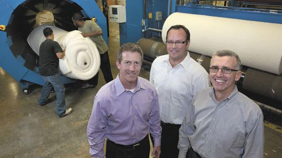 Vita Nonwovens' new owners are Kevin Womble, left, executive vice president of sales and marketing; Jason Johnson, center, executive vice president of operations; and, Cliff Lynch, executive vice president of finance.
