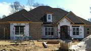 The Triad's residential real estate sector is finally beginning to experience more confidence. This photo is of a custom home in Greensboro being built by Home Team Builders.