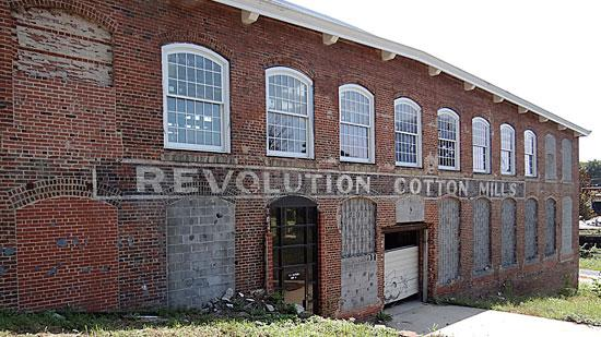 A faded sign on an exterior wall of one of the buildings at the Revolution Mill complex in Greensboro harkens back to its time as the largest flannel producer in the world.
