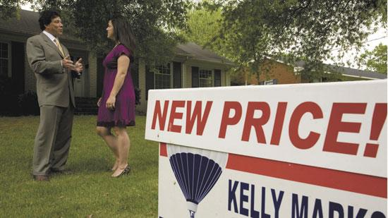 Kelly Marks with ReMax of Greensboro shows a home at 909 Moran Drive to potential buyer Michaela Haberer. Business Journal research has shown that home sales and prices throughout the Triad have dropped since 2008.