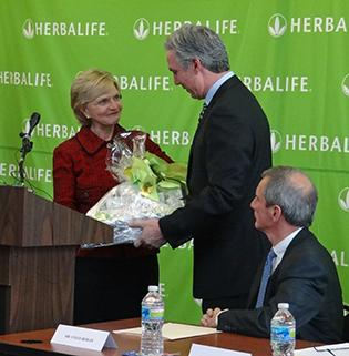 Richard Goudis, COO of Herbalife, presented Gov. Bev Perdue with a gift package from Herbalife at Wednesday's announcement. See more photos here.