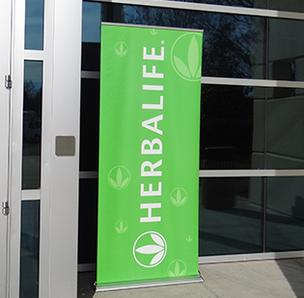 Herbalife signs greeted attendees as they walked into the former Dell plant in Winston-Salem. Herbalife will spend $130 million to purchase and upfit the plant.