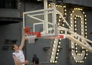 North Carolina basketball player Tyler Zeller dunks during a practice in the basketball arena on the flight deck aboard Nimitz-class aircraft carrier USS Carl Vinson.