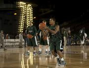 Michigan State University basketball player Keith Applinging practices in the basketball arena on the flight deck aboard Nimitz-class aircraft carrier USS Carl Vinson.