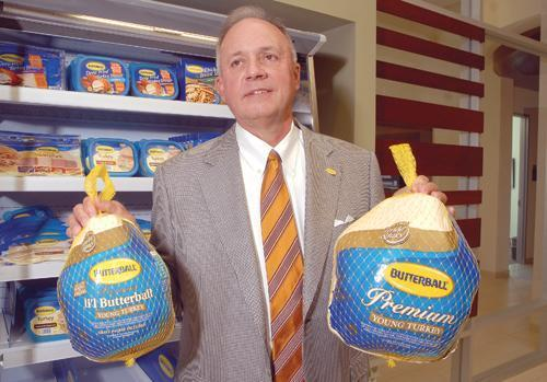 Former Butterball CEO Keith Shoemaker shows off a couple of the company's turkeys.