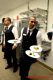 The wait staff at 1705 Events and Catering stand ready to take the fresh plates to the guests.
