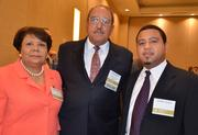 CFO Award winner George Quick with Durham County Finance, center, along with his wife Gloria and son Jeffrey.