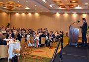 TBJ Publisher, Bryan Hamilton, right, addresses the crowd prior to the 2012 CFO Awards being handed out.