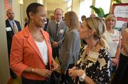 Marqueta Welton, left, with the Durham County Government, mingles with CAI's Kimberly Wheeler.