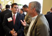 Sponsor Clay Johnson with Bank of America Merrill Lynch, left, has a conversation with CAI's Tim Wach.
