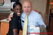 Dan Cathy stops for a quick pose with one of his employees at Cameron Village.