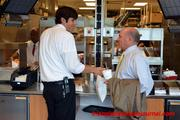 Dan Cathy checks in with one of his employees.