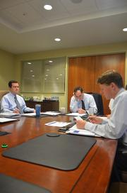 Abram's (center) spearheaded the Crescent Bank's committee meeting. Jonathan Hornaday, left, and Lee Roberts, right, were also sitting in the meeting.