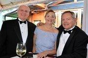 Wilson and Sharon Sawyer along with Jimmy Gilmore enjoy the North Carolina Symphony's 80th anniversary gala.
