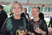 Anne Packer and Connie Eby enjoy the North Carolina Symphony's 80th anniversary gala.