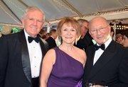 Jim and Linda Carlisle along with Edward Woolner enjoy the North Carolina Symphony's 80th anniversary gala.