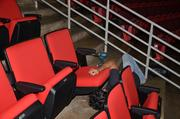 Worker installs a new Wolfpack red seat.