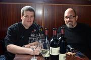 Executive Chef Robert Crawford of Sullivan's Steakhouse on Glenwood Avenue tries some of Scot Covington's award-winning wines.